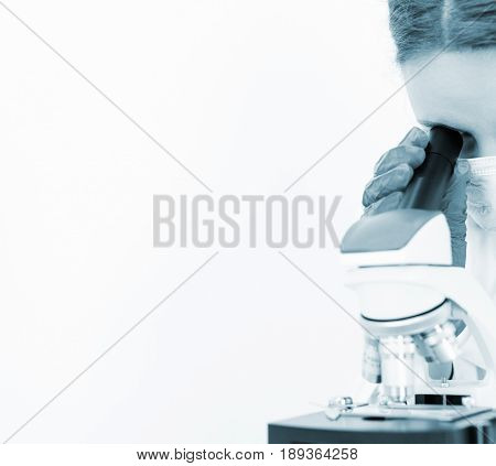 Doctor Using Microscope In Laboratory. Space For Text.