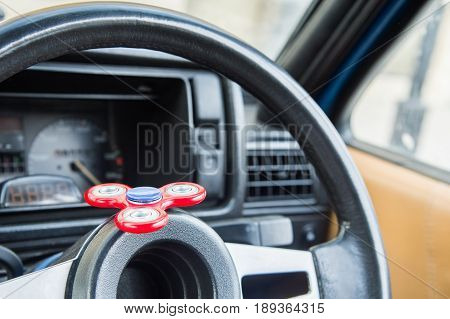 Close-up Spinner-fidget toy for shorter time being in the car in standing in the car plug on the steering wheel popular fidget spinner toy.