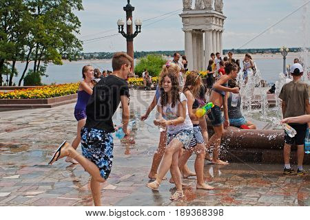 Volgograd Russia - July 01 2012: Young people taking part in Water Wars flashmob in Volgograd