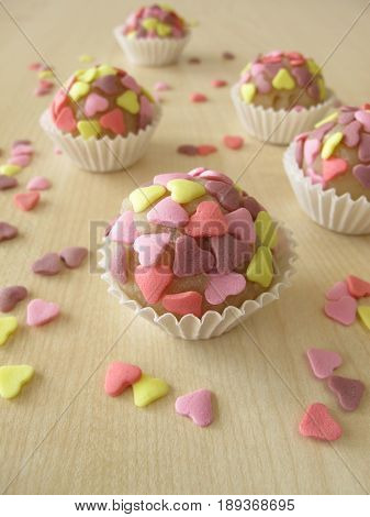 Homemade sweet marzipan pralines with sugar hearts
