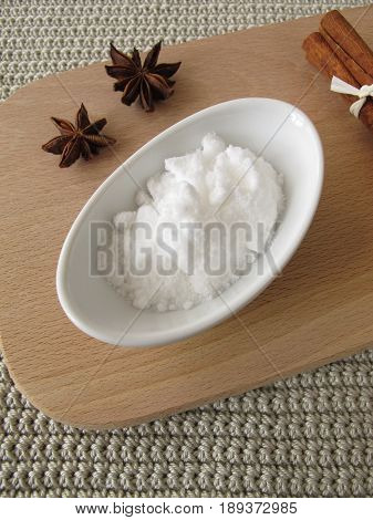Bakers ammonia in bowl and spices on wooden board
