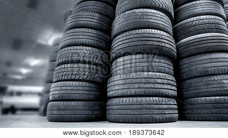 Stack of used car tires in a garage