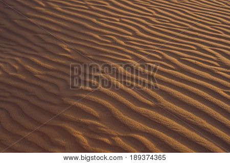 Sand With Waves In The Red Desert