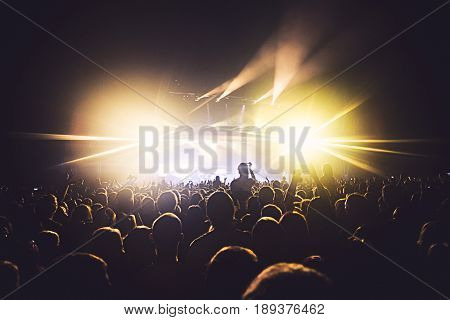 View Of Rock Concert Show In Big Concert Hall, With Crowd And Stage Lights, A Crowded Concert Hall W
