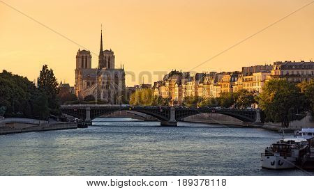 Notre Dame de Paris Cathedral Ile Saint Louis the Sully Bridge and the Seine River at sunset in Summer. 4th Arrondissement of Paris. France