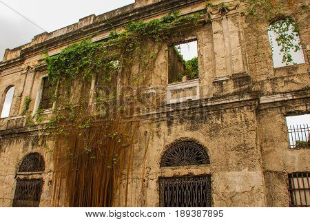 Abandoned Old Building, Overgrown With Vines. Manila, Philippines.