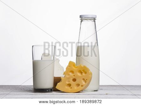 Protein products cheese cream milk eggs On a white background