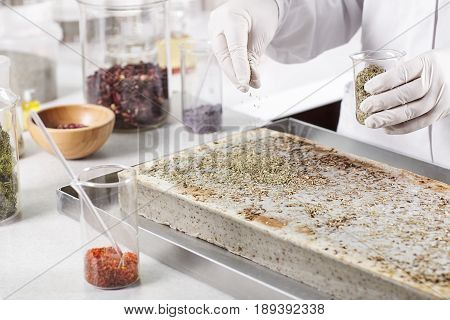 Cropped Shot Of Scientist In White Gloves Conducting Pharmaceutical Experiment In Modern Laboratory,