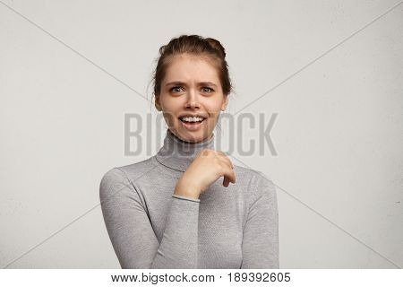 Close Up Portrait Of Charming Surprised Astonished European Woman Wearing Grey Turtleneck Looking At