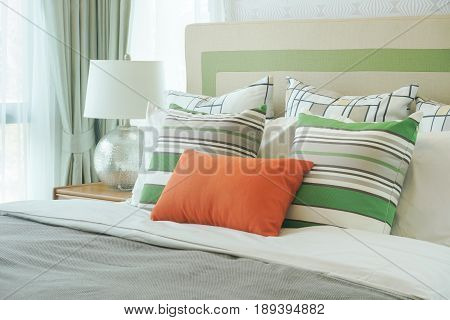 Orange Pillow With Green Pattern Pillows On Bed
