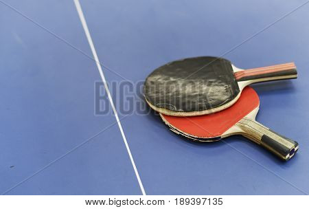 Table tennis racket on table sport
