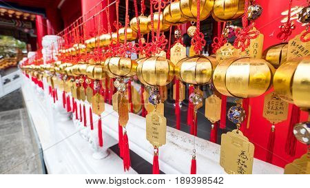 Closeup golden ball hanging for good luck at Wenwu Temple Taichung Taiwan (Chinese traditional belief)