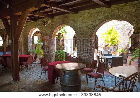 Antigua, Caribbean islands, English Harbour - May 20, 2017: Nelson's Dockyard Admiral's Inn. Inner yard cafe. Building of 18th century