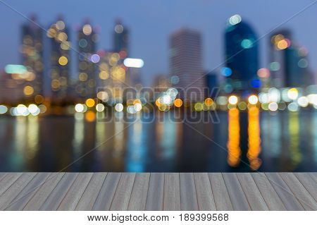 Opening wooden floor Blue twilight office building blurred bokeh light night view abstract background
