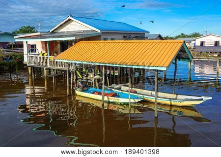 Weston,Beaufort,Sabah-May 28,2017:Weston traditional floating house with fisherman boats in Weston,Beaufort,Sabah,Borneo.Weston is a small fishing village that lies on the south western part of Sabah.