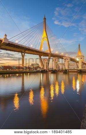 Twilight tone with reflection over suspension bridge over white watergate Bangkok Thailand landmark