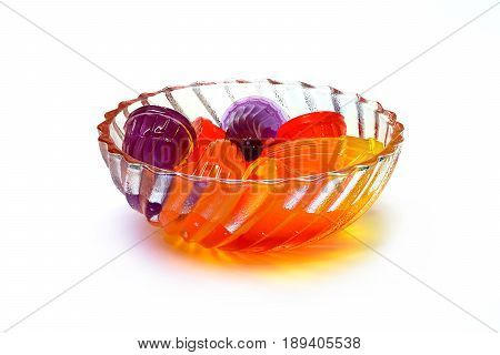Colorful jelly in clear glass bowl isolate on white background