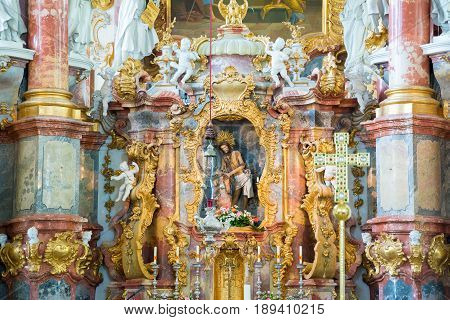 Steingaden, Germany - June 5, 2016: Altar with Jesus. Interior of Pilgrimage Church of Wies. It is an oval rococo church, designed in the late 1740s by Dominikus Zimmermann. Bavaria, Germany.