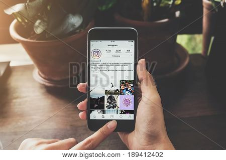 CHIANG MAI THAILAND - May 6 2017: A woman holds Apple iPhone 6S with Instagram application on the screen. Instagram is a photo-sharing app for smartphones.