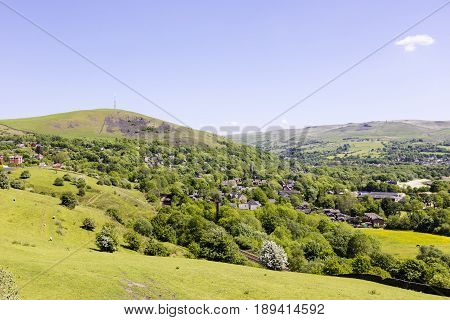 English country-side scenic landscape with railway and a village church spire.