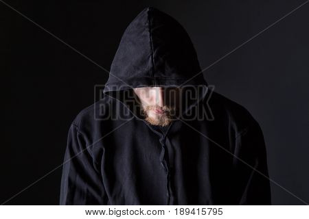 Young man wearing like bully on black background
