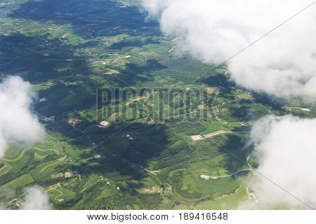 Aerial view of farm land through the clouds