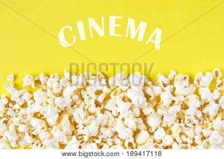 Cinema concept. Movie theater popcorn on yellow background