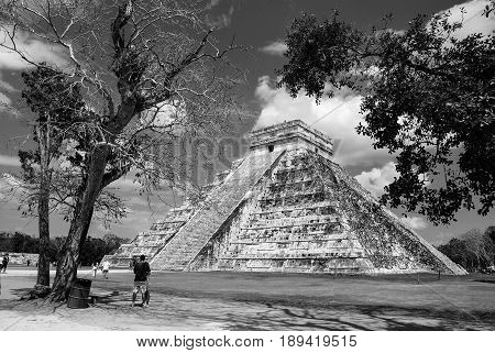 Chichen Itza, Mexico. One of the largest Mayan cities and a famous archaeological and historical site in Mexico. El Castillo or Temple of Kukulcan is a most important pyramid. Black and white