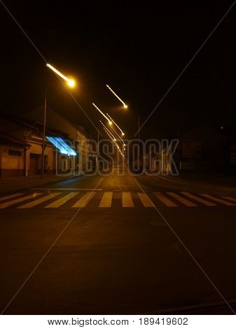 Photo of an empty street at midnight