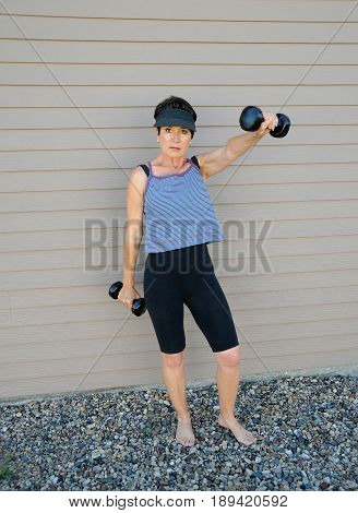 Mature female beauty working out at home.