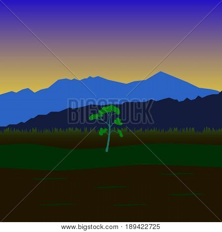 Primitive landscape with mountains fields and sole tree