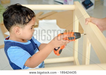 kids help parents to assembly dining table a piece of furniture with a flat top and one or more legs