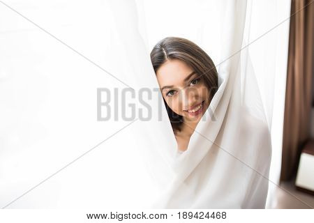Close Up Of Happy Woman Inside White Window Curtains At Home. Happy Mood