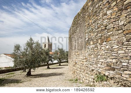 The castle wall and the clock tower in Cabeco de Vide town, Portalegre District, Portugal