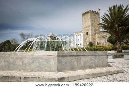 A fountain and the Castle in Alter do Chao town, District of Portalegre, Portugal