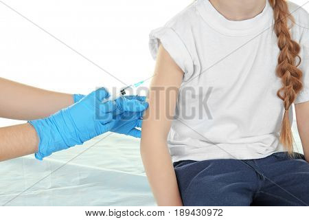 Doctor vaccinating little girl on white background, closeup