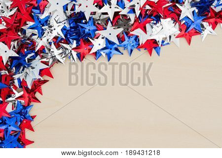 Patriotic USA red white and blue stars on wood background