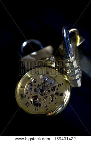 time and security with an old clock and some padlocks