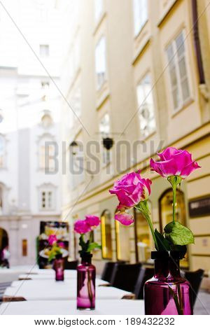 The summer platform of cafe on streets of old Salzburg Austria. A romantic dinner at restaurant.