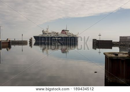 FYNSHAV DENMARK - MAY 7 2017: AlsFAERGEN ferry leaves port on may 7 2017 in Fynshav Denmark. The ferry connects Fynshav with Bojden in Denmark.