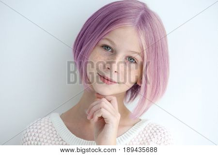 Lilac color for trendy hairstyle ideas. Girl with dyed hair on light background