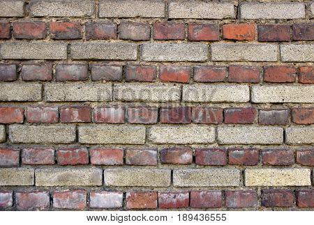 Old Brick wall as Background. Outdoor shot.