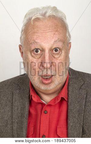 Senior man looking astonished - on bright background