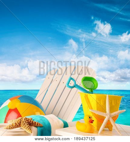 Beach toys on summer chair by the ocean