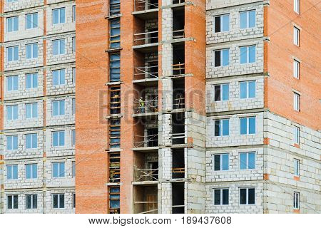 Facade of a multi-storey residential building under construction