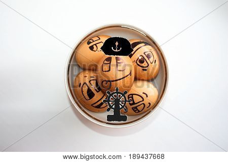 Eggs with painted face. Photo for your design. Egg to swim in a plate. To come off to the fullest. Joy and relaxation. Vacation. The captain at the helm of the ship.