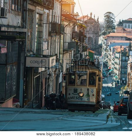 PORTO, PORTUGAL - MAR 4, 2017: On one of the streets in old downtown. City of Porto was elected from 20 selected Best European Destinations 2017 and won this prestigious title.