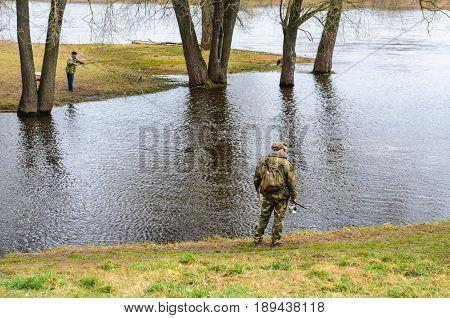 Belarus Orsha - April 11 2017: Fishermens on the river bank