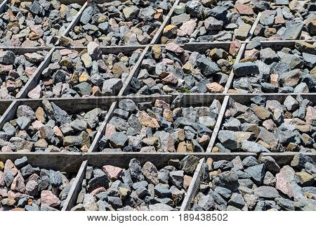 The texture of the surface is strewn with stones. Untreated Cobblestone Background