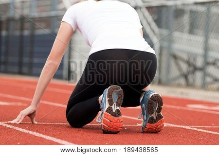 Female High school track sprinter in the
